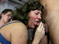 Two aged grannys suck cocks in orgy