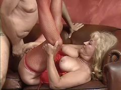 Lusty granny in stockings sucks cock and fucks