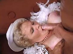Plump granny gets fast titsfuck from energetic guy