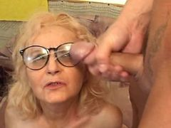 Lustful granny gets cum on glasses after hard fuck