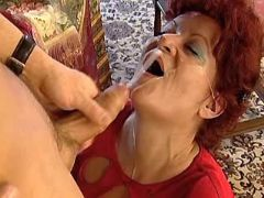 Redhead grandma in stockings gets cum on face