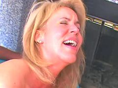 Lovely milf gets pounded with huge black stick