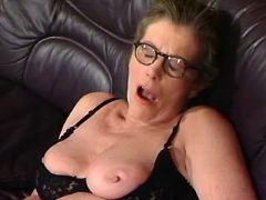 Granny satisfied by milf playmate on leather sofa