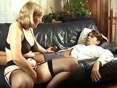 Blond granny seduces innocent dude on leather sofa