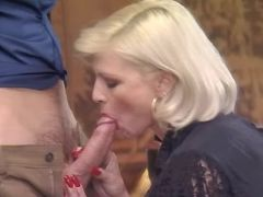 Beautiful blonde mature deep throats hard cock