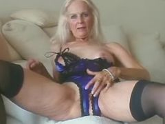Grandma in stockings plays with old tired pussy