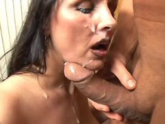 Brunette mature with big boobs gets cum on face
