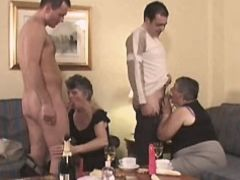 Two grannies sucking cocks in orgy