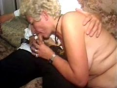 Kinky granny in stockings sucks hard cock of guy