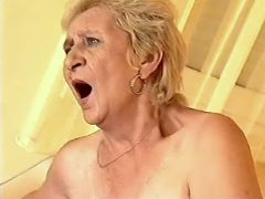 Horny granny throats cock and rides him on sofa