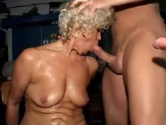 Granny sucking numerous cocks in dirty gangbang