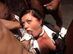 Lewd old maid geedily sucks numerous black cocks