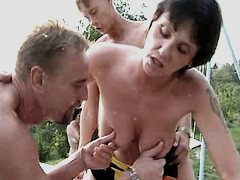 Elder mom fucks w two guys outdoor