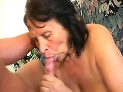 Busty brunette granny sucks hard cock