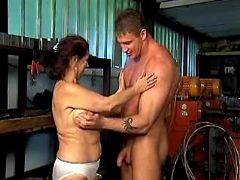 Nice old lady seduces man in garage and sucks him
