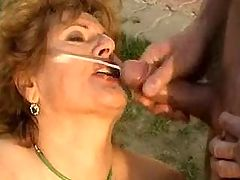 Chubby granny gets double penetration and cum outdoor