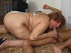 Fat grandma sucks hard cock of guy in bedroom