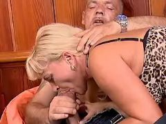Blonde mature greedily sucks big cock of older man